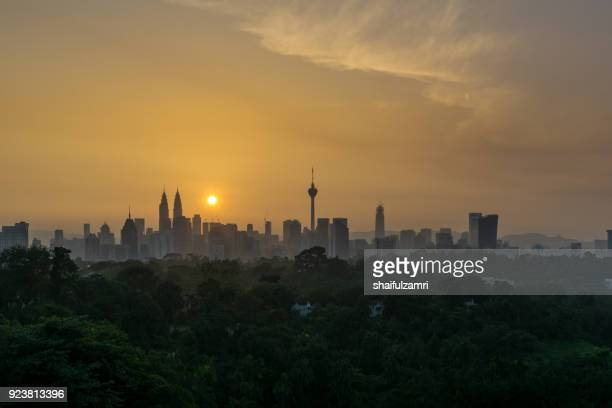 view of majestic sunrise over downtown kuala lumpur, malaysia - shaifulzamri stock pictures, royalty-free photos & images