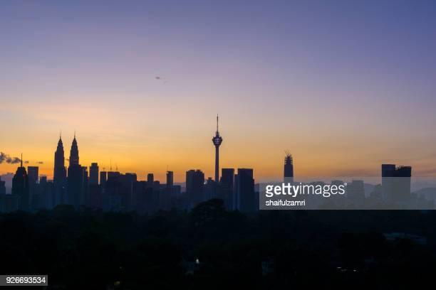 view of majestic sunrise over downtown kuala lumpur, malaysia - shaifulzamri stock pictures, royalty-free photos & images