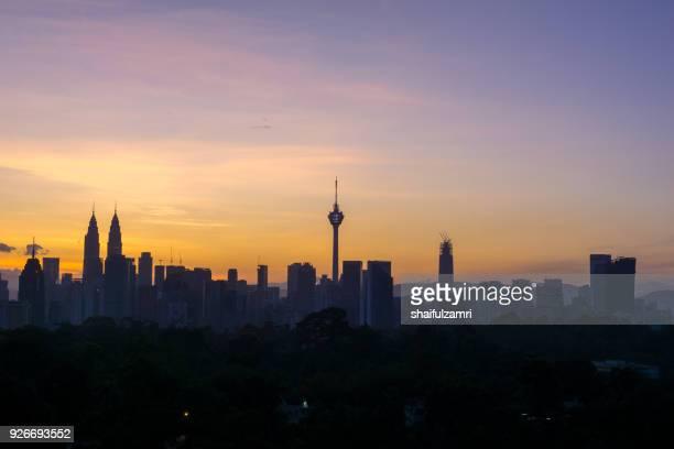view of majestic sunrise over downtown kuala lumpur, malaysia - shaifulzamri imagens e fotografias de stock
