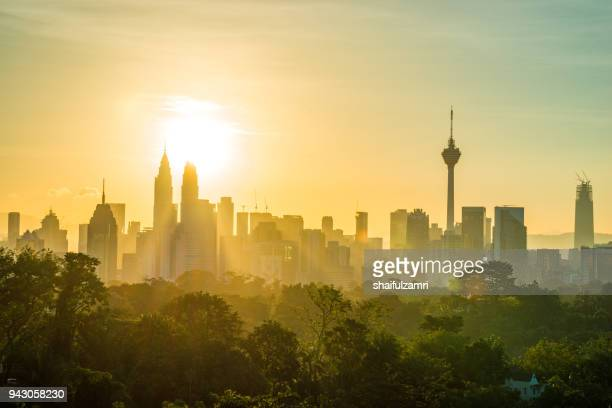 view of majestic sunrise over downtown kuala lumpur, malaysia. - malaysia stock pictures, royalty-free photos & images