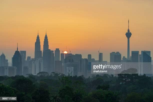 View of majestic sunrise over downtown Kuala Lumpur, Malaysia