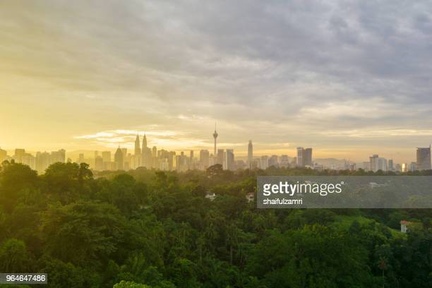 view of majestic sunrise over kl tower and surrounded buildings in downtown kuala lumpur, malaysia. - shaifulzamri stock pictures, royalty-free photos & images