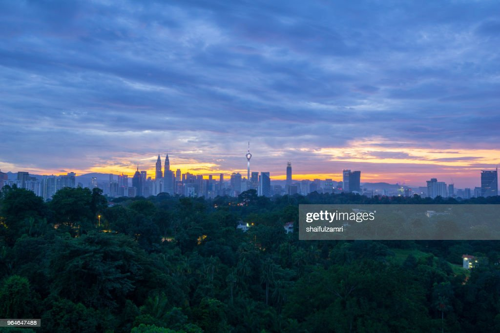 View of majestic sunrise over KL Tower and surrounded buildings in downtown Kuala Lumpur, Malaysia. : Stock Photo