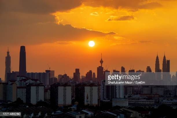 view of majestic sunset over down town kuala lumpur, malaysia - shaifulzamri stock pictures, royalty-free photos & images