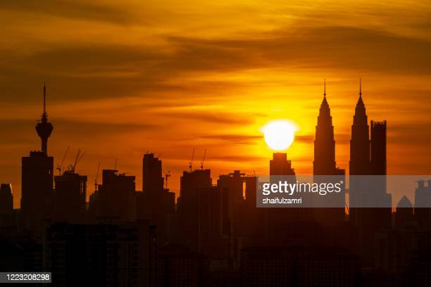 view of majestic sunset over down town kuala lumpur, malaysia. - shaifulzamri stock-fotos und bilder