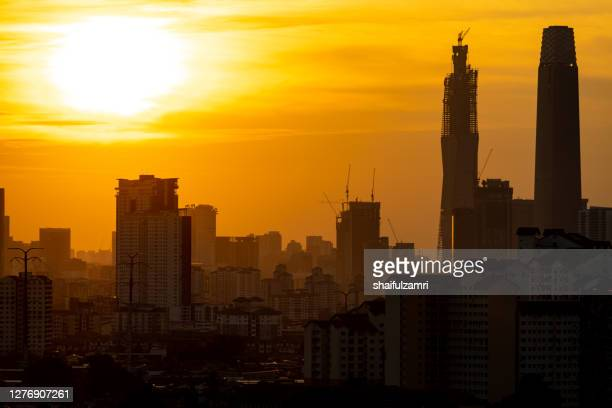 view of majestic sunset over down town kuala lumpur, malaysia. - shaifulzamri stock pictures, royalty-free photos & images