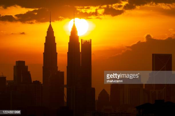 view of majestic sunset over down town kuala lumpur. - shaifulzamri stock pictures, royalty-free photos & images