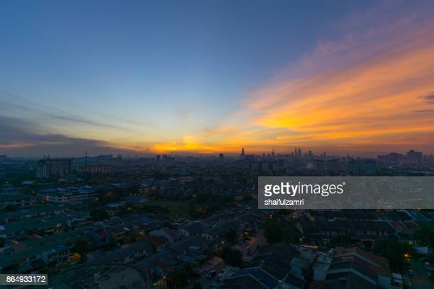 view of majestic sunset over downtown kuala lumpur, malaysia - shaifulzamri stock pictures, royalty-free photos & images
