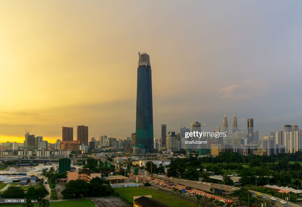 View of majestic sunset over Exchange 106 tower (formerly known as TRX Signature). The tower still under construction and will become highest tower in Malaysia. : Stock Photo