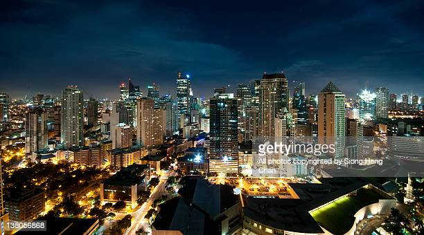 view of makati at night - manila philippines stock pictures, royalty-free photos & images