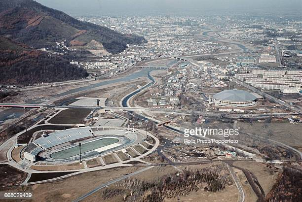 A view of Makomanai Park with the Makomanai Ice Arena Olympic Village and Makomanai Speed Skating Rink under construction in Sapporo Japan in...