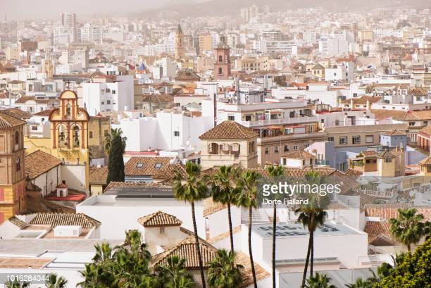 View of Malaga city on a sunny misty day