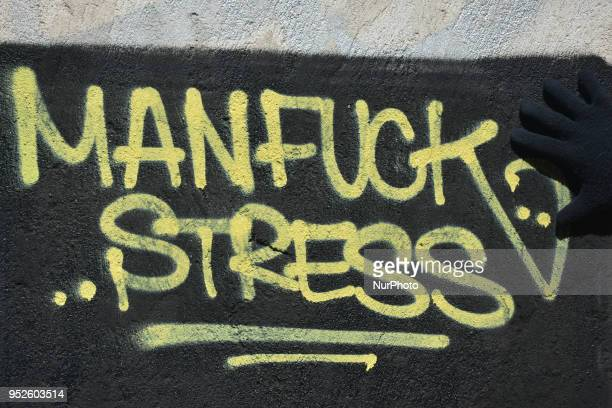 A view of 'Man Fuck Stress' inscription seen on a wall in Dublin city center On Saturday April 28 in Dublin Ireland