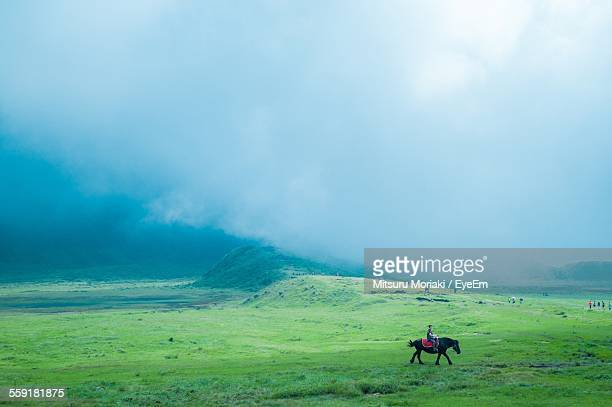 view of man riding horse - kumamoto prefecture stock pictures, royalty-free photos & images