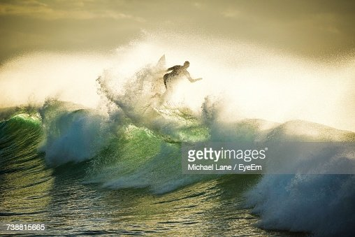 View Of Man Surfing On Wave