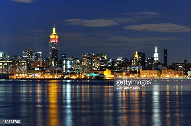 CONTENT] View of Manhattan New York from Hoboken New Jersey at nigh Cityscape skyline New York City Manhattan Downtown Midtown Empire State Building...