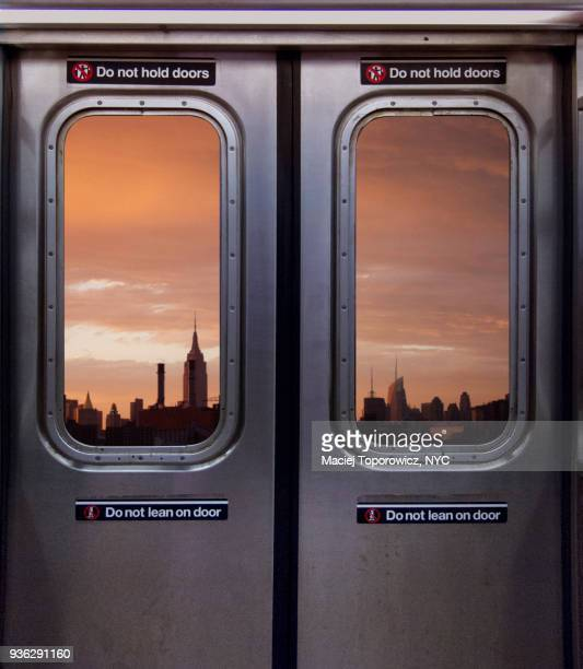view of manhattan skyline through a subway window - subway stock pictures, royalty-free photos & images