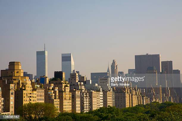 view of manhattan's east side (fifth avenue co-ops) in late afternoon looking southeast from the rooftop garden at the metropolitan museum of art in central park, new york city - metropolitan museum of art new york city stock pictures, royalty-free photos & images