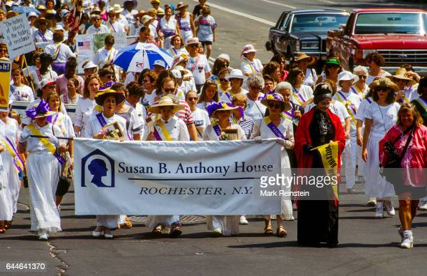 View of marchers from the Susan B Anthony House as they walk along Pennsylvania Avenue during a rally in honor of the 75th anniversary of the...