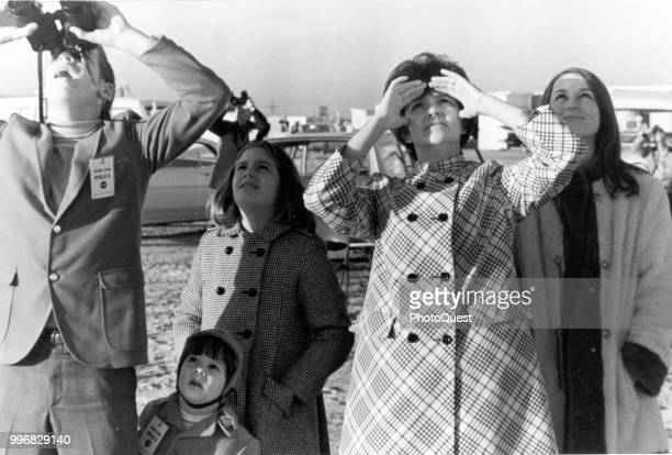View of Marilyn Lovell along with her children as they watch the liftoff of a Saturn V rocket that carries her husband on the Apollo 8 mission at...
