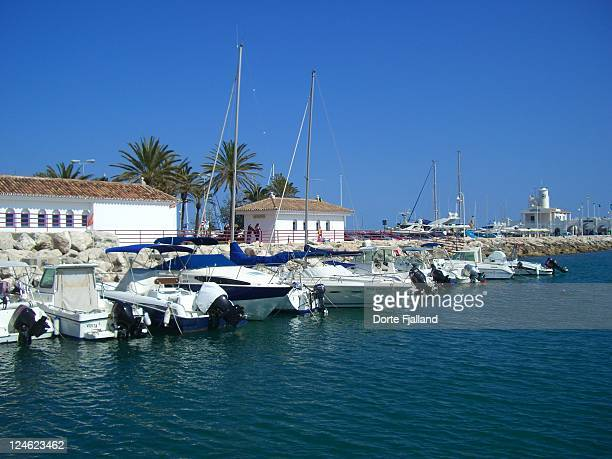 view of marina with blue sky and sea - dorte fjalland stock-fotos und bilder