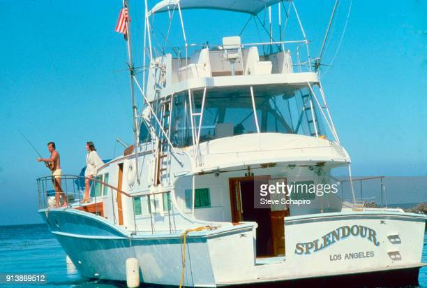 View of married American actors Robert Wagner with a fishing rod and Natalie Wood on their yacht the 'Splendour' October 8 1976