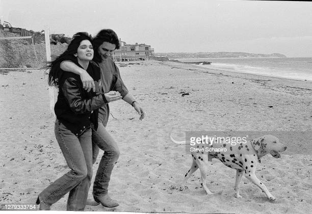 View of married couple, American actress Valerie Bertinelli and Dutch-born American Rock musician Eddie Van Halen as they walk with their dog on the...