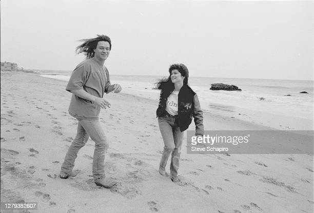 View of married couple, American actress Valerie Bertinelli and Dutch-born American Rock musician Eddie Van Halen as they walk on the beach, Los...