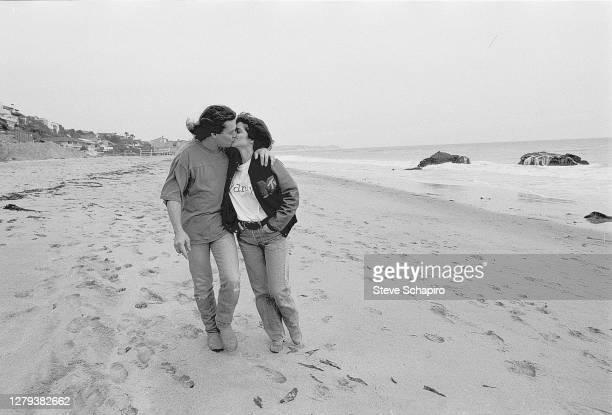 View of married couple, American actress Valerie Bertinelli and Dutch-born American Rock musician Eddie Van Halen as they kiss on the beach, Los...