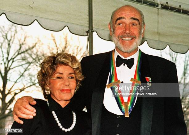 View of married couple FrenchMoroccan artist Micheline Roquebrune Connery and Scottish actor Sean Connery as they arrive at the White House...