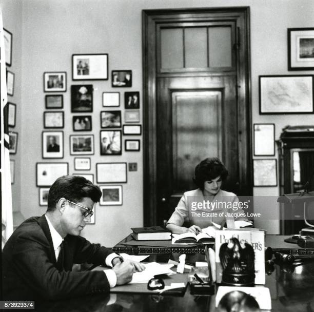 View of married couple Senator John F Kennedy and Jacqueline Kennedy as they work together in the former's Capitol Hill office Washington DC Fall 1958