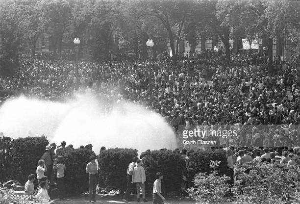 View of massed demonstrators around the fountain in front of Smithsonian Museum of History and Technology during a nationwide student strike ,...