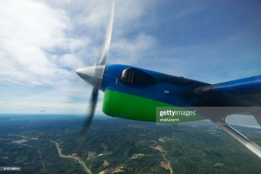 View of MASwings Twin Otter aircraft in flight from Miri to Bario which take about 1 hour flight time. : Stock Photo