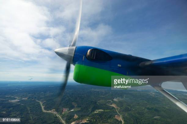 view of maswings twin otter aircraft in flight from miri to bario which take about 1 hour flight time. - propeller stock pictures, royalty-free photos & images