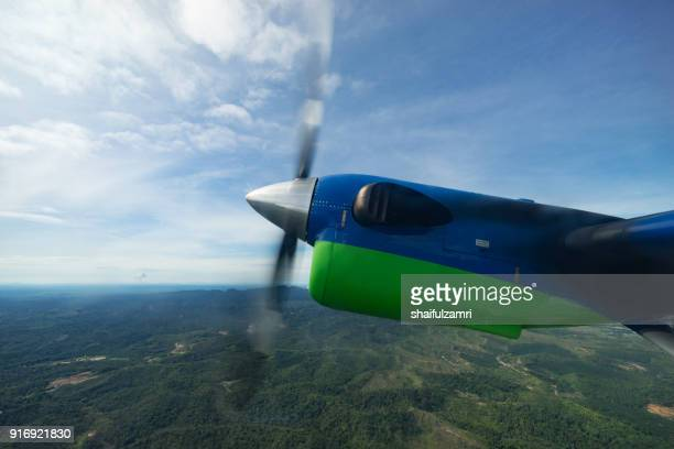 view of maswings twin otter aircraft in flight from miri to bario which take about 1 hour flight time. - shaifulzamri stock pictures, royalty-free photos & images