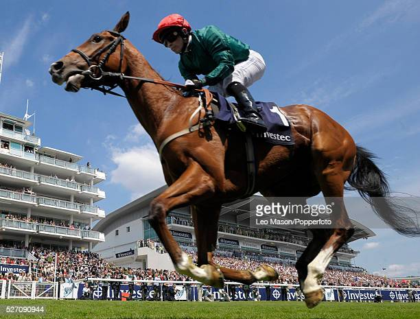 View of Mathouse ridden By Silvestre De Sousa competing in the Investec Horses Help Heroes Handicap race at Epsom Downs racecourse on 4th June 2011...