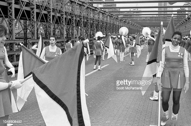 View of members of a marching band as they cross the Brooklyn Bridge during its 100th birthday celebrations in Brooklyn New York New York May 24 1983