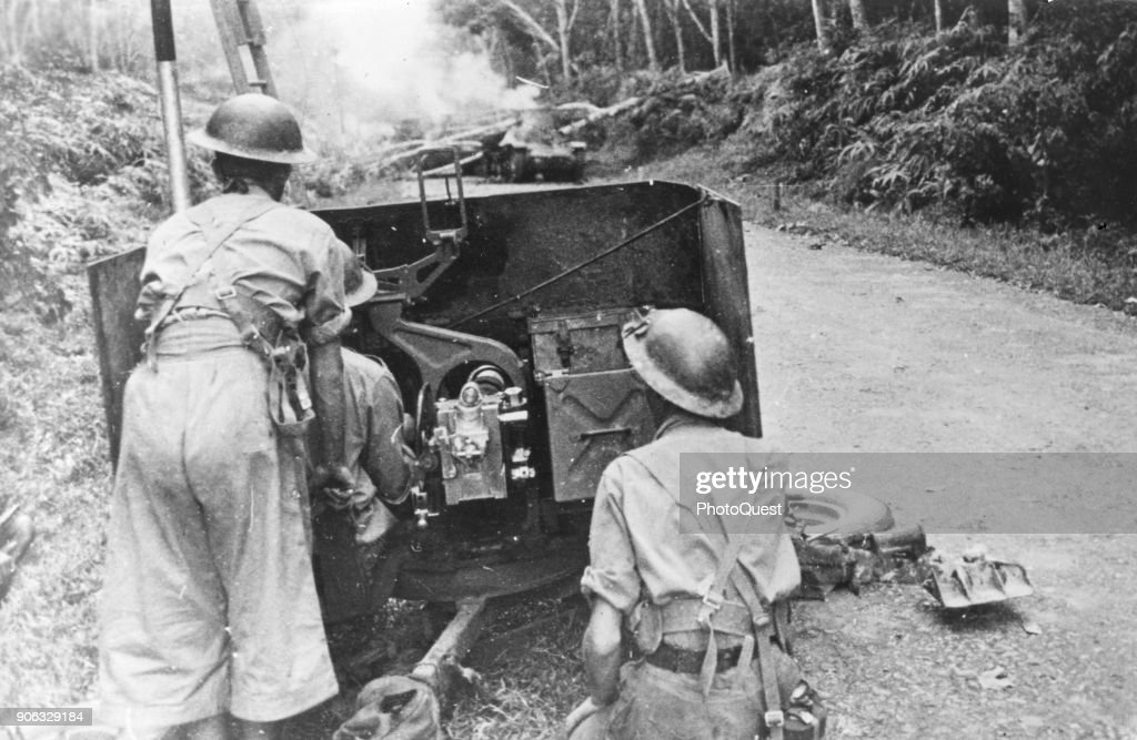 view of members of an australian anti tank gun crew as they fire