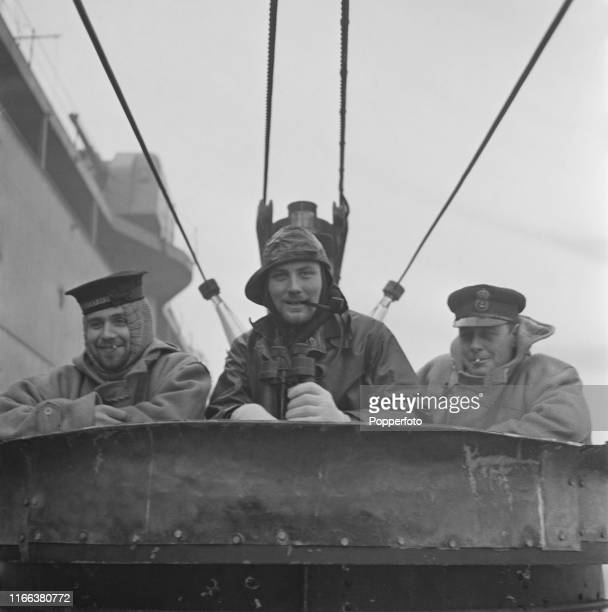View of members of crew of a Royal Navy submarine pictured together on the bridge of a British submarine prior to going back on patrol during...