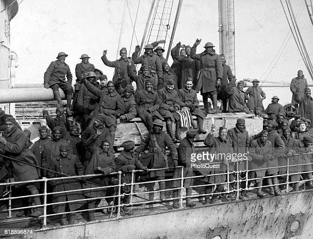 View of members of New York's 369th Infantry Regiment return home after World War I fighting in France Hoboken New Jersey 1919