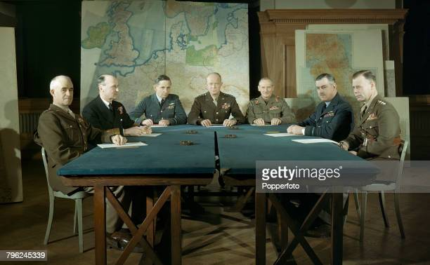 View of members of the Allied Supreme Command pictured in conference around a table to discuss upcoming D-Day invasion plans at the Supreme...