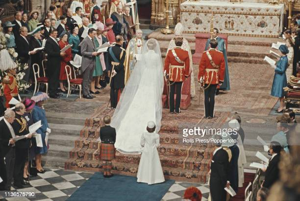View of members of the British royal family including Queen Elizabeth II Prince Philip Duke of Edinburgh and Prince Charles attending the wedding...
