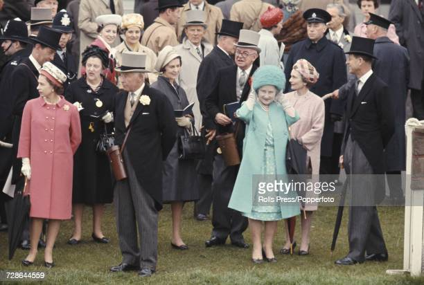 View of members of the British royal family including Queen Elizabeth II on far left Bernard FitzalanHoward 16th Duke of Norfolk Queen Elizabeth the...