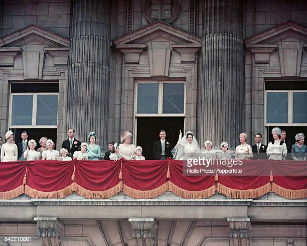 View of members of the British Royal family standing on the balcony at Buckingham Palace after the wedding of Princess Margaret to Antony...
