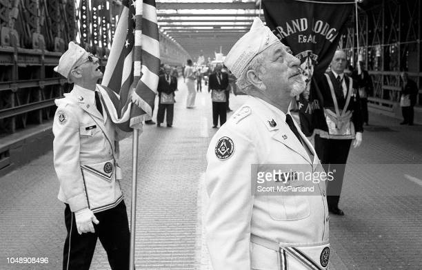 View of members of the Grand Lodge of the State of New York as they march across the Brooklyn Bridge during its 100th birthday celebrations in...