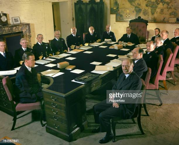 View of members of the New Board of Admiralty meeting at The Admiralty in London in July 1943 Delegates seated around the large board room table are...
