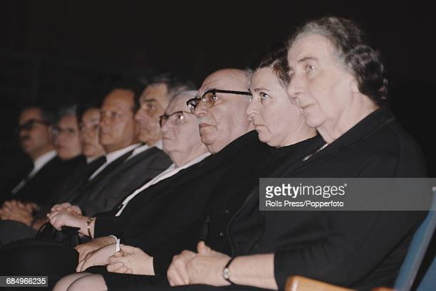 View of members of the new Israel government team under the leadership of Israeli politician and Prime Minister Golda Meir pictured sitting together...