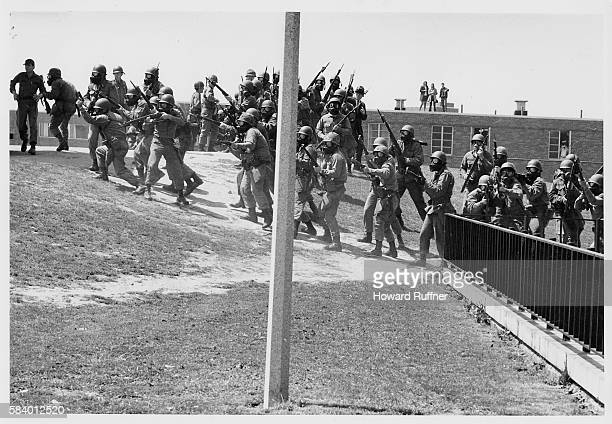 View of members of the Ohio National Guard as they begin to fire upon antiwar demonstrators and students at Kent State University Kent Ohio May 4...