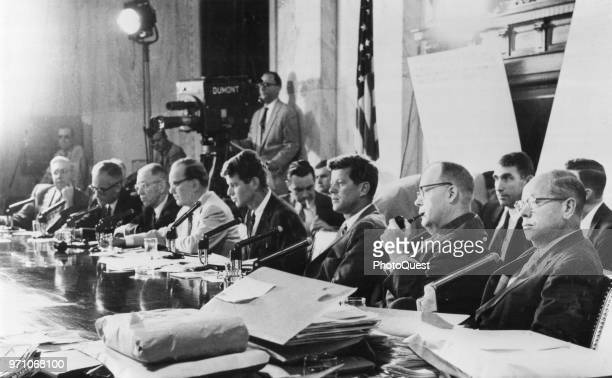View of members of the US Senate's Committee on Activities in the Labor and Management Field as they sit a ta table during a hearing Washington DC...