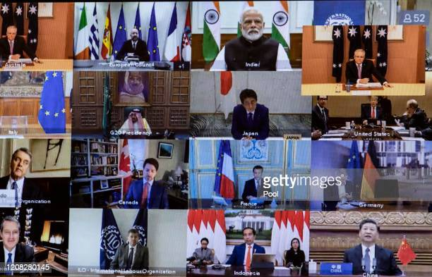 View of members taking part on screen during an unusual G20 Leaders' Summit to discuss the international coronavirus crisis on March 26, 2020 in...